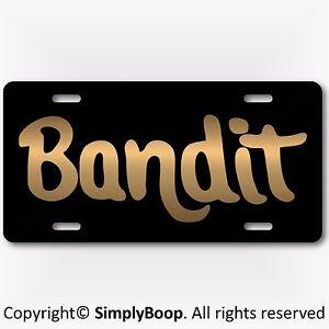 BANDIT-Smokey-amp-The-Bandit-Prop-Reproduction-Aluminum-License-Plate-Gold-Color