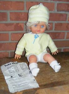 BeBe Llora Baby Doll wearing Sweater, Hat, Shorts, Pacifier and Socks