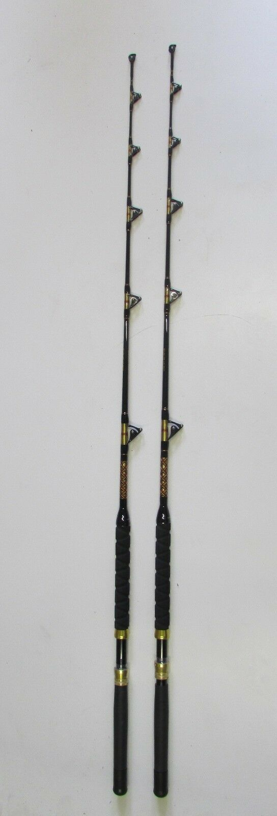 XCALIBER MARINE  PAIR OF SALTWATER TROLLING ROD  50-80lb (gold AND RED TRIM)  offering 100%