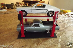 Scale red diorama 4 post car lift for your work shop garage very cool