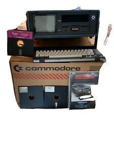 commodore 64 vintage computers mainframes with manual, floppy discs, keyboard