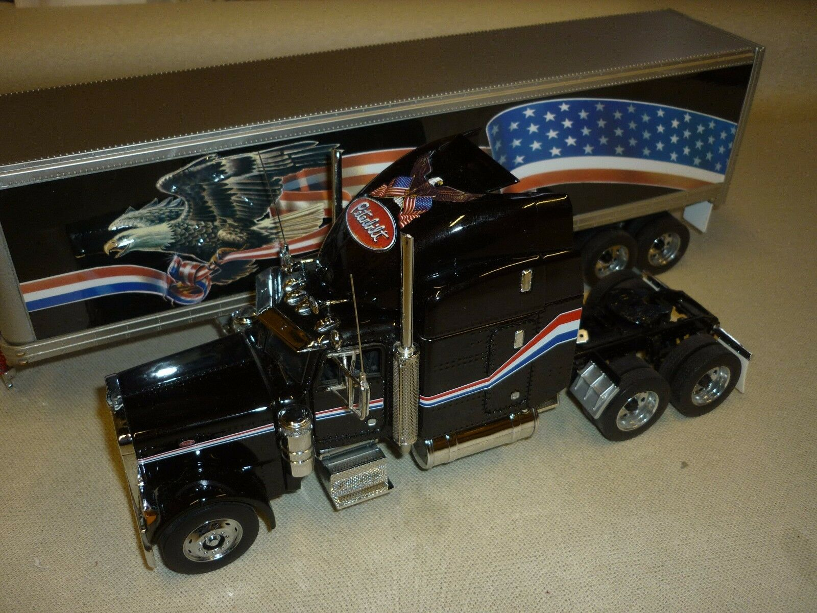 A Franklin mint scale model of a Peterbilt model 379, with reefer trailer