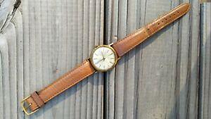 Ancienne montre marque Rolys dorée bracelet en cuir