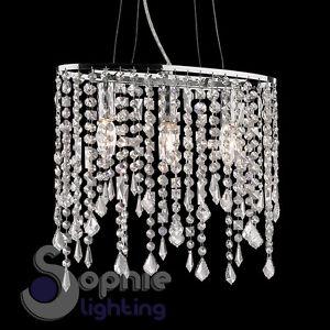 Lampada-sospensione-ovale-cristalli-pendenti-cascata-design-moderno-cromato