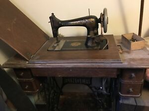 Antique Singer Sewing Machine With