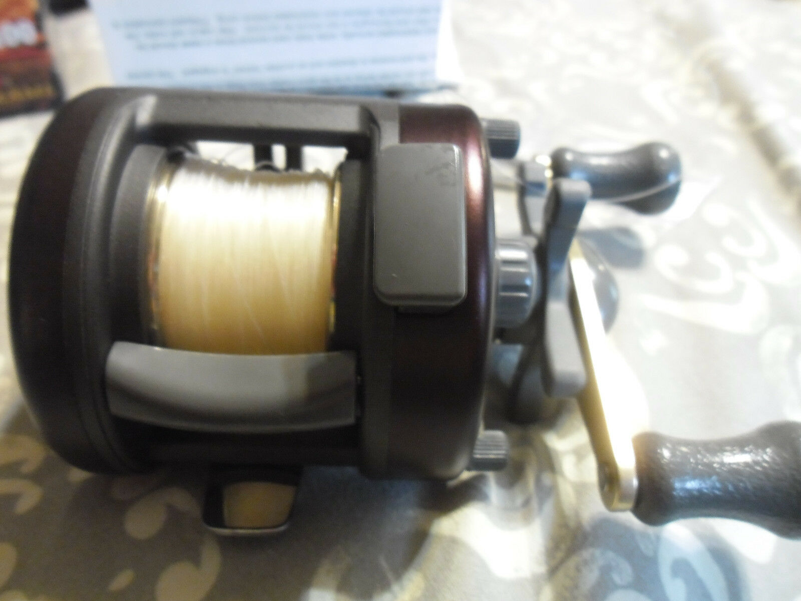 Quantum HR100 Baitcast Fishing Reel New in Box w wrench  etc. & 12  wrench Stren filled 6e9588