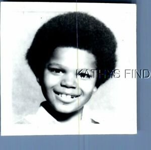 FOUND B&W PHOTO E+4374 POTRAIT OF BLACK CHILD WITH AFRO SMILING