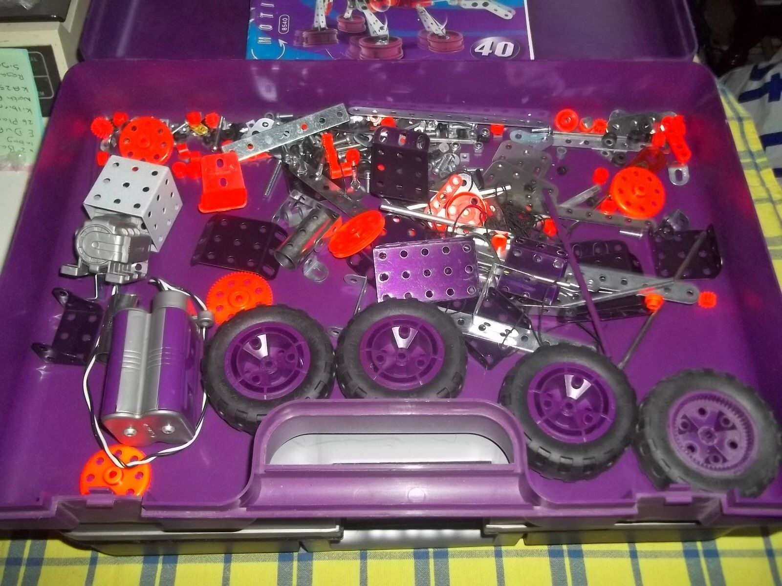 Large collection of Meccano including motor, wheels & a nice purple storage box