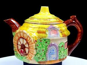 JAPANESE-POTTERY-COTTAGE-SHAPED-amp-WATER-WHEEL-4-1-2-034-BRANCH-HANDLE-TEA-POT-1940s