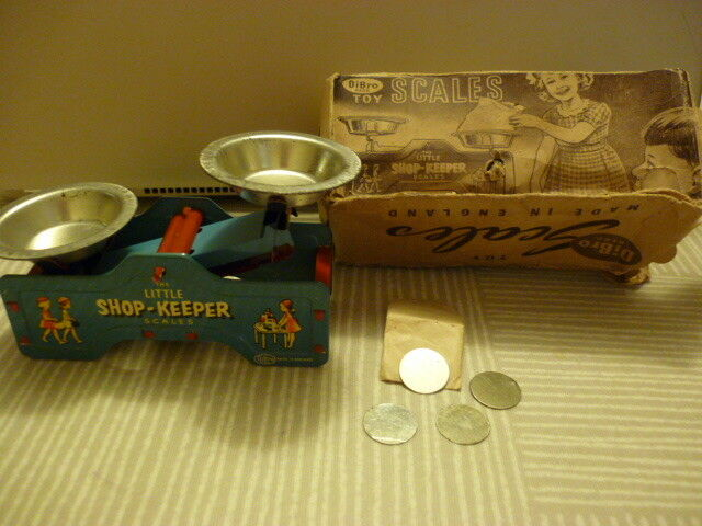 DiBro tin plate little shop keeper   toy scales with weights