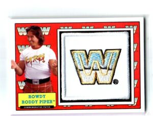WWE-Rowdy-Roddy-Piper-2017-Topps-Heritage-WWF-Com-Patch-Relic-Card-SN-279-of-299