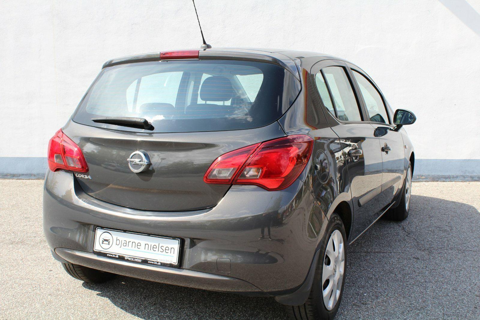 Opel Corsa 1,4 16V Enjoy aut. - billede 1