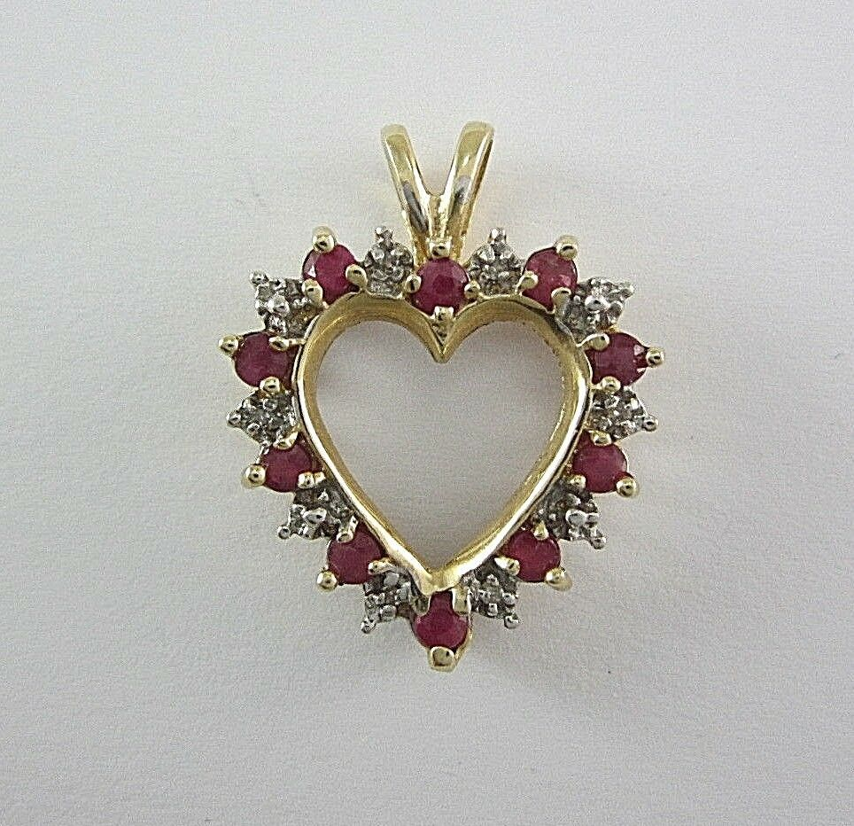 LADIES 10K YELLOW gold RUBY AND DIAMOND HEART-SHAPED PENDANT; TDW 0.03CT. 2.5G