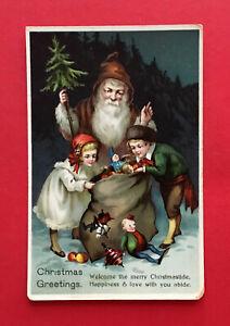 Kuenstler-Glueckwunsch-AK-WEIHNACHTEN-um-1910-Weihnachtsmann-mit-Geschenken-56689