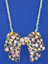 Betsey Johnson Goldtone Fairyland Multi Charm Large Bow Thread Weave Necklace