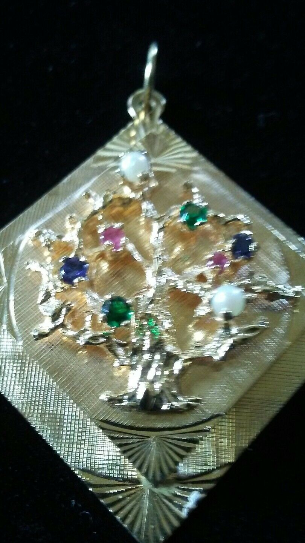 14kt gold mid century tree of life charm ---estate item---7.7 gr.