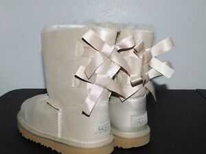 34dab0304b2 Details about NEW NWOB KIDS GIRLS SIZE 3 GOLD UGG BAILEY BOW II SHIMMER  SUEDE SHEEPSKIN BOOTS