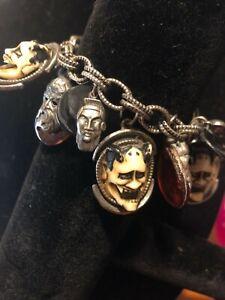 Antique-FLORENZA-bracelet-featuring-HAND-CARVED-DEVILS-FACES-ON-IT