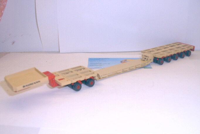 03555   7achs Tiefladeauflieger mit Baggerbett      Baumann     (642)