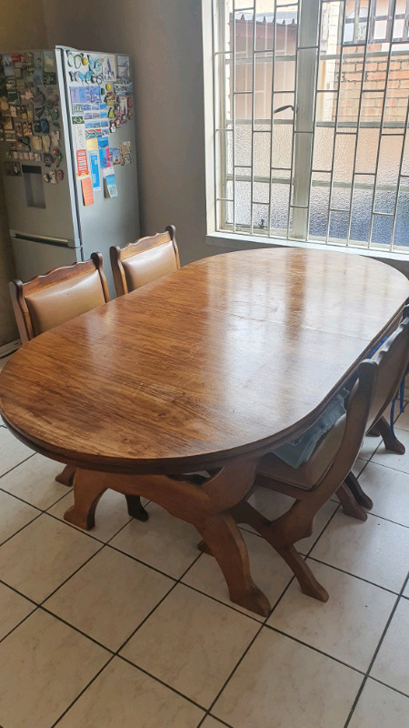 Solid oak dining table, chairs and cabinet suite R6,000.00 neg