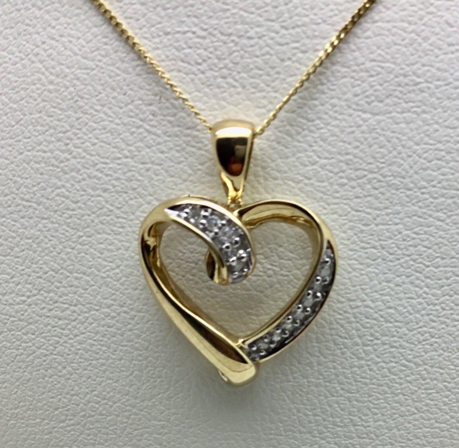 9ct gold heart pendant set with Diamonds