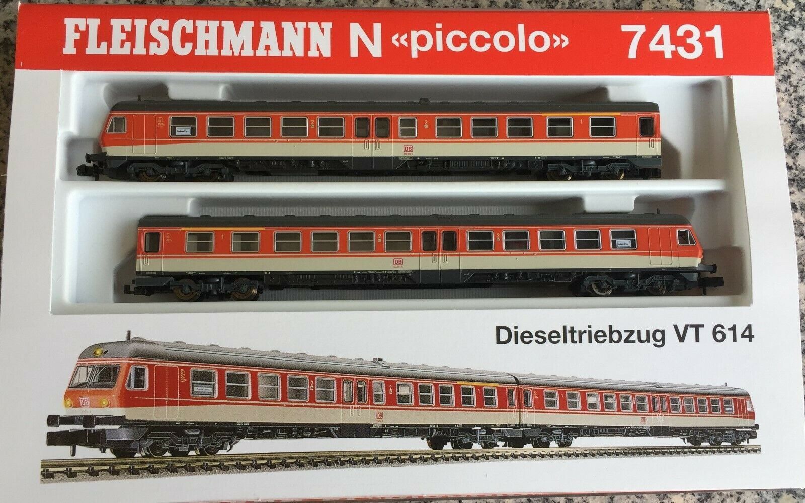 FLM 7431+7433 Dieseltriebwagen+Mittelwagen 3-teilig, BR. 614,kieselgrau Orange