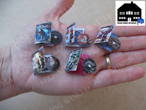 Set 5 videogame miniature boxes. Scale 1/6.Uncharted,The last of us, Jak&Daxter.