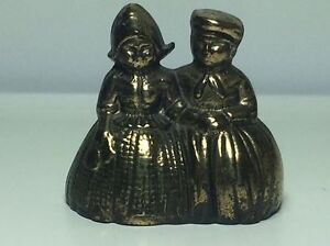 Vintage brass bell Dutch couple