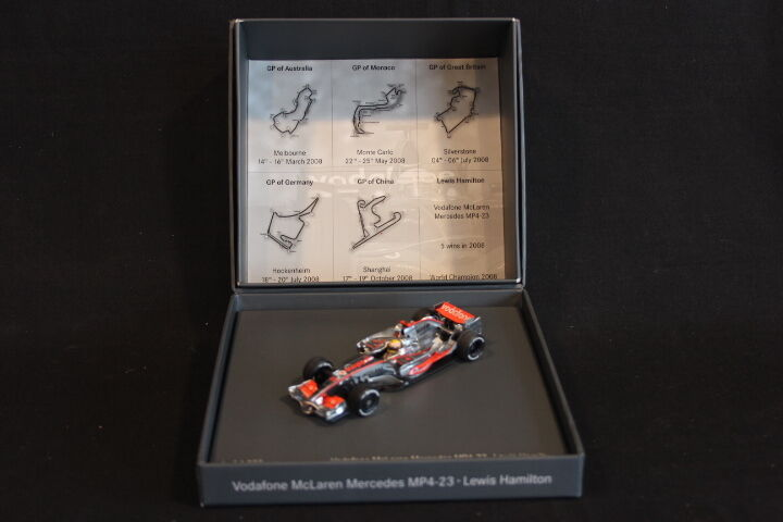 Minichamps McLaren Mercedes MP4 23 2008 1 43  22 Hamilton World Champion (JS)