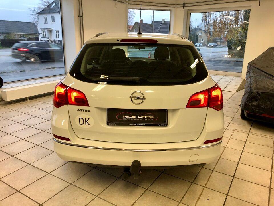 Opel Astra 1,4 100 Sport ST Benzin modelår 2013 km 72000 Hvid
