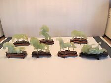 Seven Vintage Chinese Hand Carved Natural Green Jade Horses On Wooden Stands