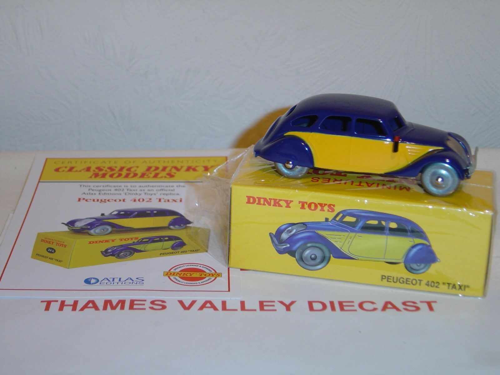 ATLAS EDITIONS DINKY TOYS, 24L, PEUGEOT 402  TAXI  + CERTIFICATE OF AUTHENTICITY