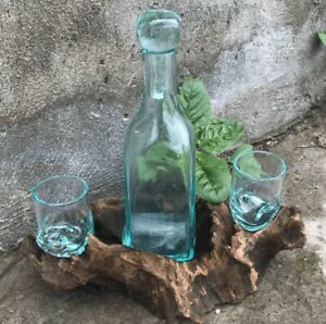 New-molton-glass-drinks-decanter-on-wood-and-two-glasses