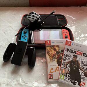 Nintendo Switch 32 Go Console Portable avec Manettes Joy-Con Bleu Néon/Rouge