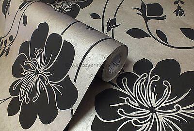 Matt Black Flower On A Metallic Background Wallpaper by Arthouse 910801