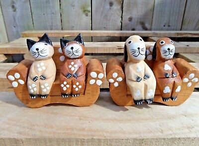 Animals on sofa wooden ornament handcarved fair trade