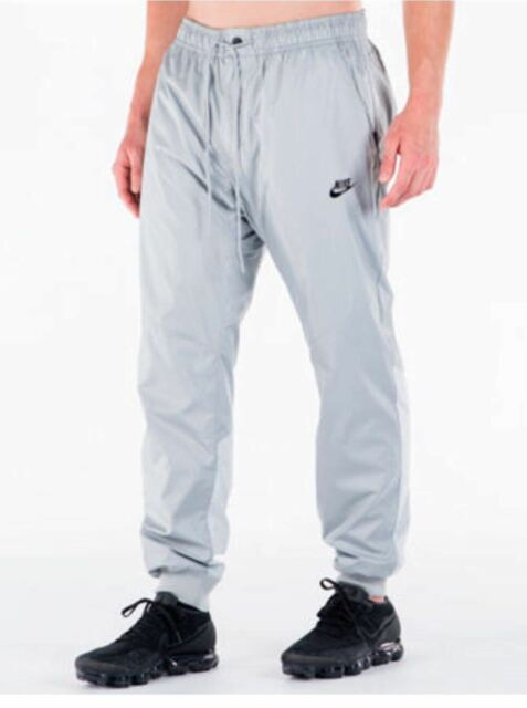900b400399a1 898403-012 New with tag MEN S NIKE windrunner cuffed Jogger Pants  85