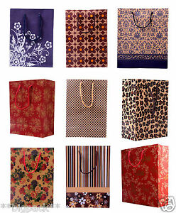 PATTERNED BOUTIQUE CARDBOARD RETAIL CARRIER BAGS WITH HANDLES-RECYCLED PAPER