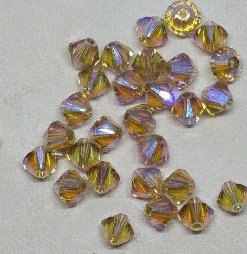 Swarovski Crystal Limited Edition Lt Colorado Topaz Shimmer 2X 4mm Bicone Beads