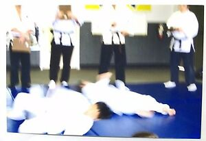 vintage 90s photo blurry action shot of karate fight w instructors