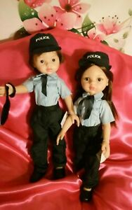 2-MUNECA-MUNECO-PAOLA-REINA-POLICE-POLICIA-NUEVOS-33-32-CM-ENTERO-VINILO