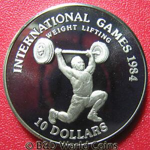 1984-LIBERIA-10-PROOF-WEIGHT-LIFTER-INTERNATIONAL-GAMES-CU-NI-38mm-no-silver