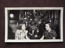 2 YOUNG GIRLS IN FRONT OF CHRISTMAS TREE, LIGHT IN WINDOW ABSTRACT PHOTO