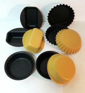 Nine-small-yellow-baking-pans-non-stick