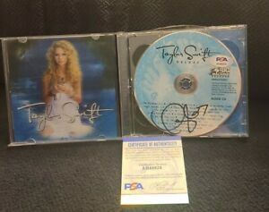 TAYLOR-SWIFT-SIGNED-TAYLOR-SWIFT-CD-DELUXE-CD-OUR-SONG-PSADNA-AUTHENTIC-AH48828