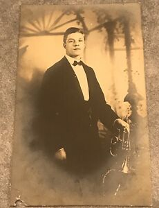 Postcard-Handsome-Young-Man-In-Tuxedo-With-A-Trumpet-real-photo