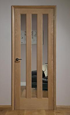 Alnwick 3 Panel Clear Glazed Oak Veneered Interior Door. Vertical 3 Panel
