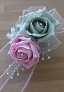 Wedding-flowers-bridesmaids-wrist-corsage-baby-pink-silver-roses-diamante-pearls