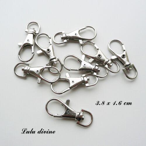 2 Mousquetons / Fermoir en métal argenté, pivot demi-ovale : 3.8 x 1.6 cm