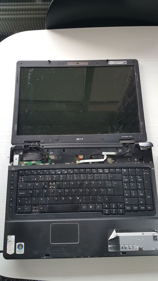 Acer travelmate 7520 model ms 2209, Amd athlon 64 GHz, 1 GB